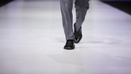 photo of male model walking along runway