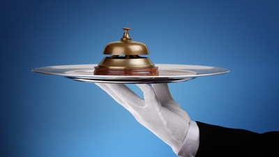 Hotel reception service bell on a silver tray concept for assistance and support